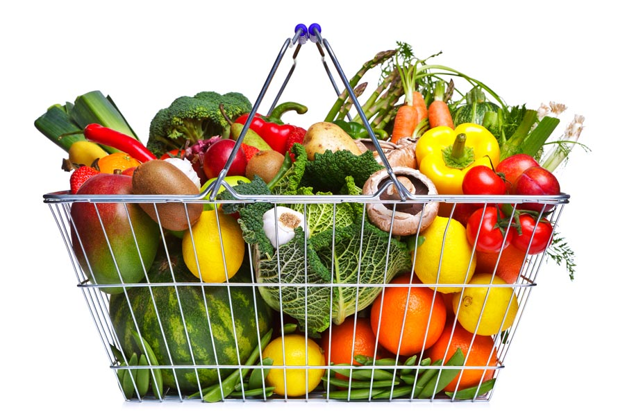 shopping basket overflowing with fruit and vegetables