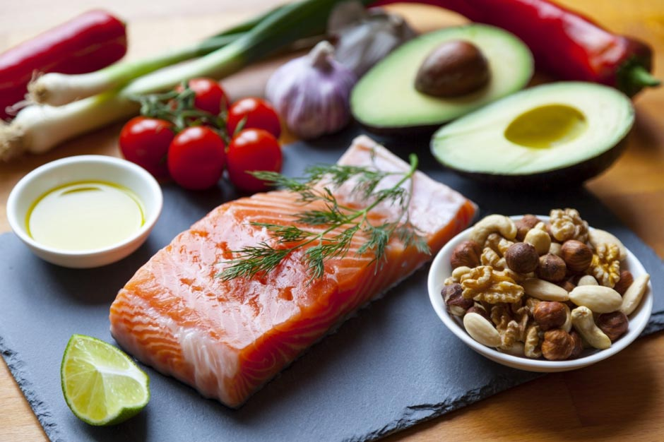 salmon fillet surrounded by nuts and vegetables