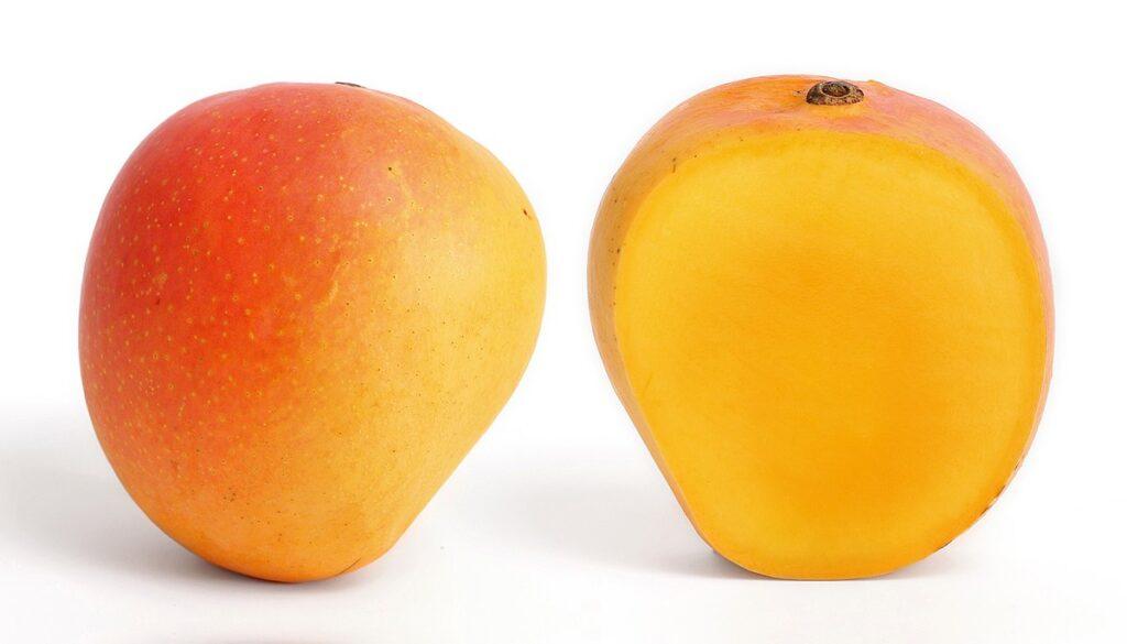 A nectarine cut in half
